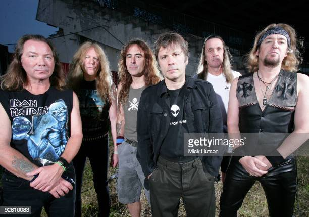 Dave Murray Janick Gers Steve Harris Bruce Dickinson Nicko McBrain and Adrian Smith of Iron Maiden pose for a group portrait at the Lokomotiv Stadium...