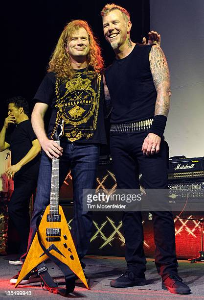 Dave Mustaine and James Hetfield of Metallica pose at Day Four of the bands' 30th Anniversary shows at The Fillmore on December 10 2011 in San...