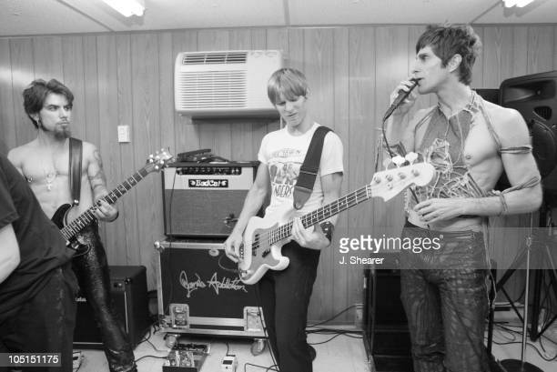 Dave Navarro Chris Chaney and Perry Farrell of Jane's Addiction rehearse in their tuning room backstage