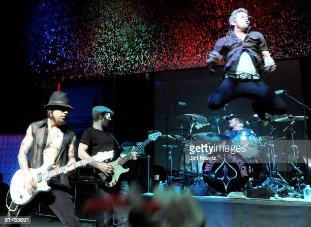 Dave Navarro Chris Chaney Matt Sorum and Mark McGrath performs at The Surfrider Foundation's 25th Anniversary Gala at the California Science Center's...