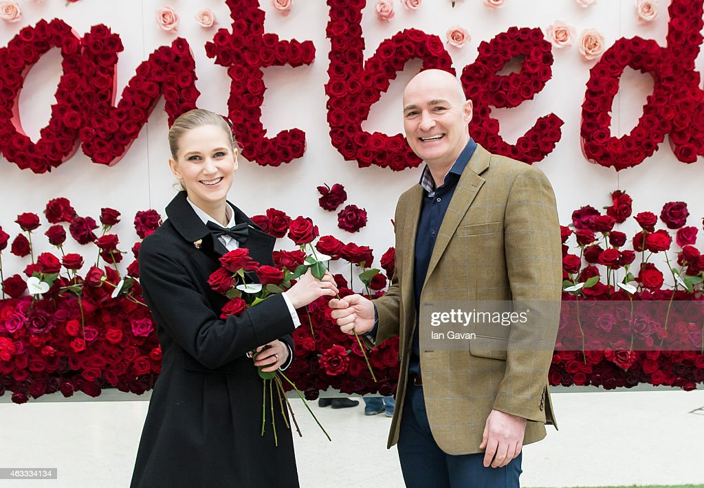 Dave Nicholl receives a Valentine's rose from ASDA. A new survey by Asda has revealed over half of British women have never received flowers on Valentine's Day and Dave is the most likely to forget his loved one this year. Asda has created a living floral billboard allowing Londoners, like Dave to take a single red rose for their Valentine #dontbedave at Victoria Station on February 13, 2015 in London, England.