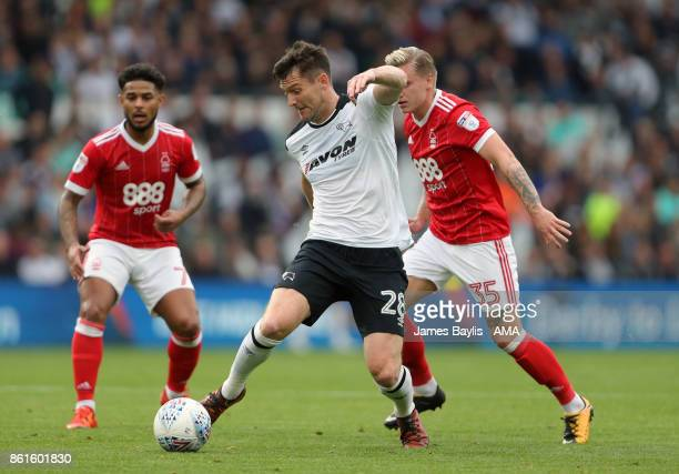 Dave Nugent of Derby County and Jason Cummings of Nottingham Forest during the Sky Bet Championship match between Derby County and Nottingham Forest...
