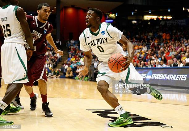 Dave Nwaba of the Cal Poly Mustangs drives to the basket against the Texas Southern Tigers during the first round of the 2014 NCAA Men's Basketball...