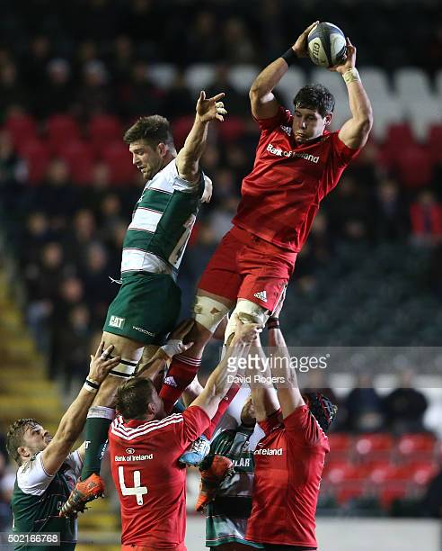 Dave O'Callaghan of Munster wins the lineout ball over Mike Fitzgerald during the European Rugby Champions Cup match between Leicester Tigers and...