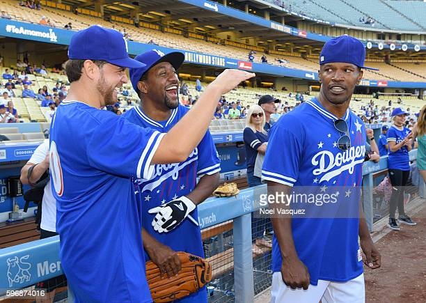 Dave Osokow Jaleel White and Jamie Foxx attend the Hollywood Stars game at Dodger Stadium on August 27 2016 in Los Angeles California