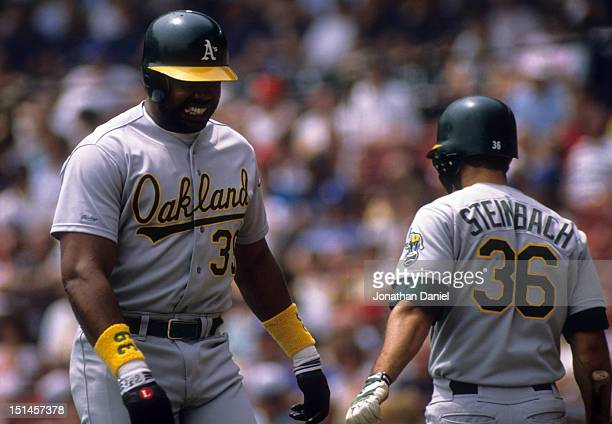 Dave Parker of the Oakland Athletics walks by teammate Terry Steinbach during an MLB game against the Milwaukee Brewers in July 1989 at Milwaukee...