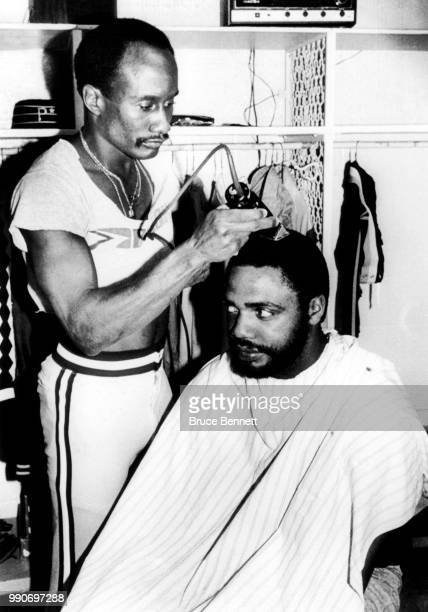 Dave Parker of the Pittsburgh Pirates has his hair cut by teammate Matt Alexander before Game 1 of the 1979 World Series against the Baltimore...