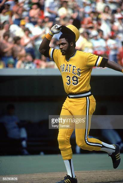 Dave Parker of the Pittsburgh Pirates tips his hat as he rounds the bases during an MLB game at Three Rivers Stadium in Pittsburgh Pennsylvania
