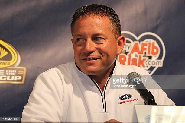 Dave Pericak director of Ford performance speaks at a press conference prior to the NASCAR Sprint Cup Series myAFibRiskcom 400 at Chicagoland...