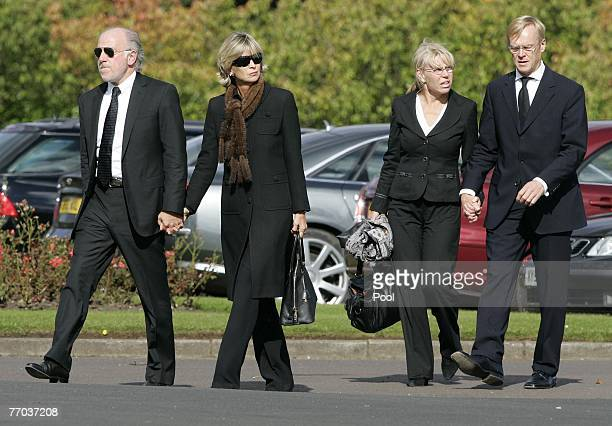 Dave Richards and Ari Vatanen and their partners arrive for the funeral of Colin McRae and son Johnny at East Chapel, Daldowie Crematorium on...