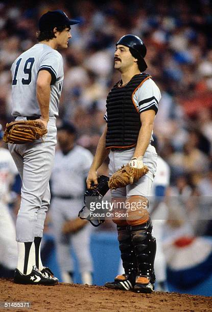 Dave Righetti and Rick Cerone of the New York Yankees talk on the mound against the Los Angeles Dodgers during the World Series at Dodger Stadium in...