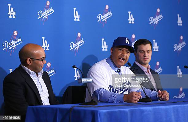 Dave Roberts center speaks as Farhan Zaidi left Los Angeles Dodgers general manager and Andrew Friedman right Dodgers President of Baseball...