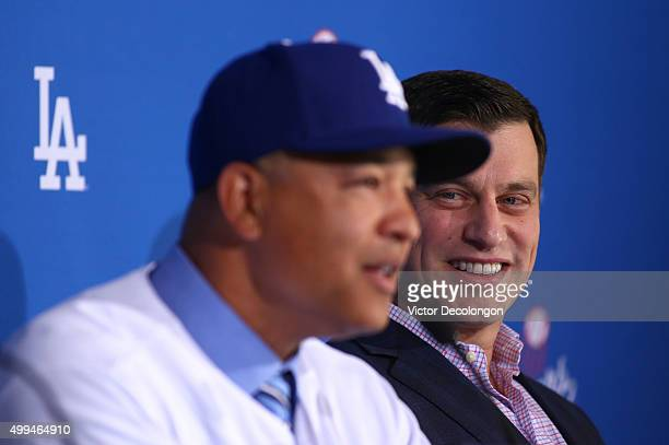 Dave Roberts left speaks as Andrew Friedman Dodgers President of Baseball Operations looks on during a press conference to introduce Roberts as the...
