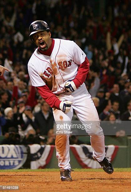 Dave Roberts of the Boston Red Sox celebrates after scoring the game-tying run on a single by Bill Mueller in the ninth inning against the New York...