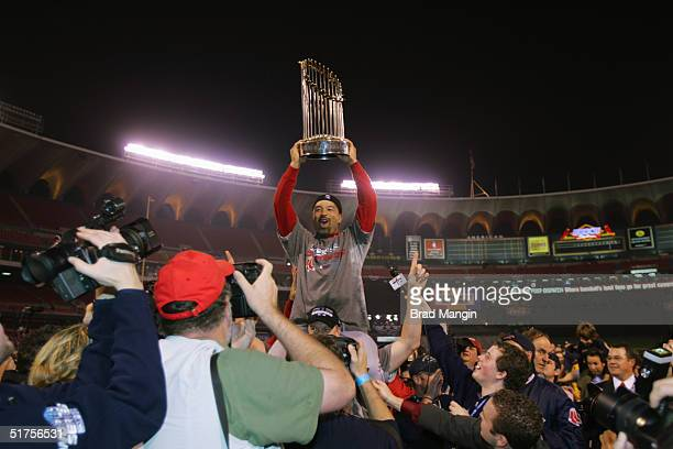 Dave Roberts of the Boston Red Sox celebrates after winning game four of the 2004 World Series against the St. Louis Cardinals at Busch Stadium on...