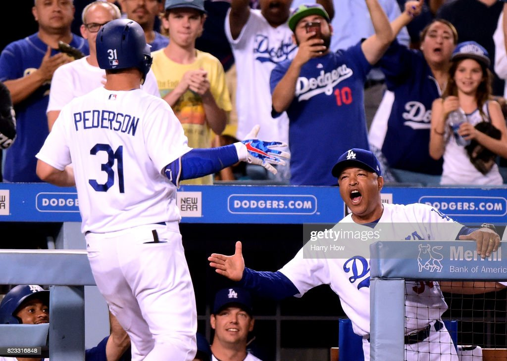 Dave Roberts #30 of the Los Angeles Dodgers celebrates the solo homerun of Joc Pederson #31 to tie the game 2-2 during the fifth inning against the Minnesota Twins at Dodger Stadium on July 24, 2017 in Los Angeles, California.