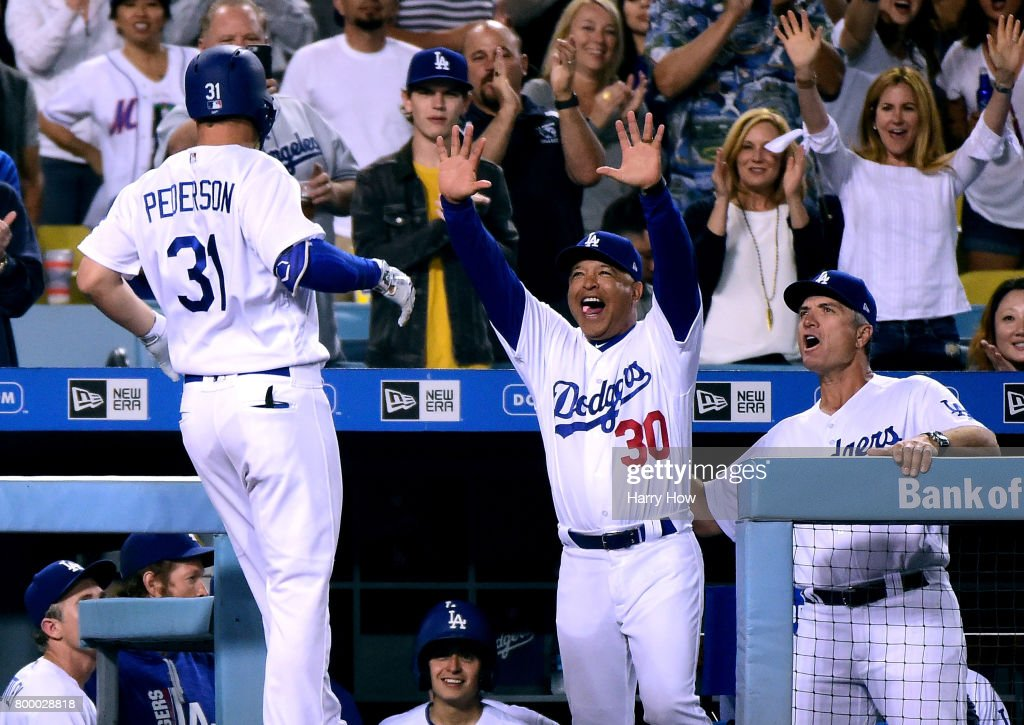 Dave Roberts #30 of the Los Angeles Dodgers reacts to a solo homerun from Joc Pederson #31 to take a 4-3 lead over the New York Mets during the seventh inning at Dodger Stadium on June 22, 2017 in Los Angeles, California.