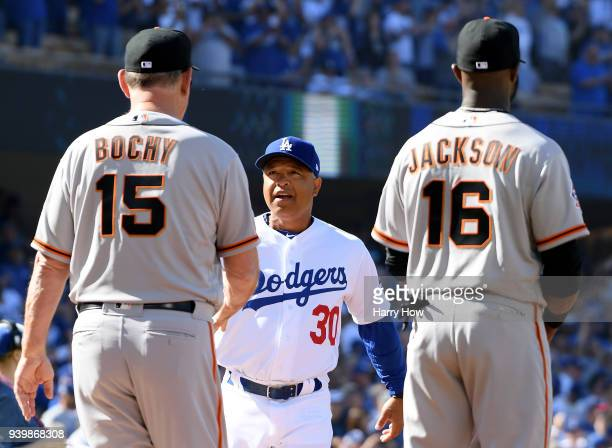 Dave Roberts of the Los Angeles Dodgers shakes hands with Bruce Bochy of the San Francisco Giants before the game during the 2018 Major League...