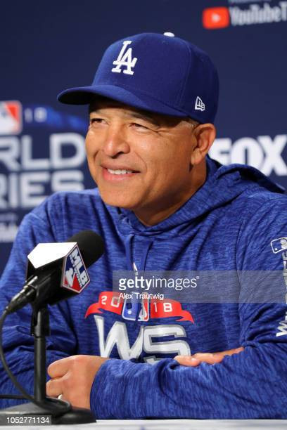 Dave Roberts of the Los Angeles Dodgers speaks to the media during the workout day for the 2018 World Series between the Los Angeles Dodgers and the...