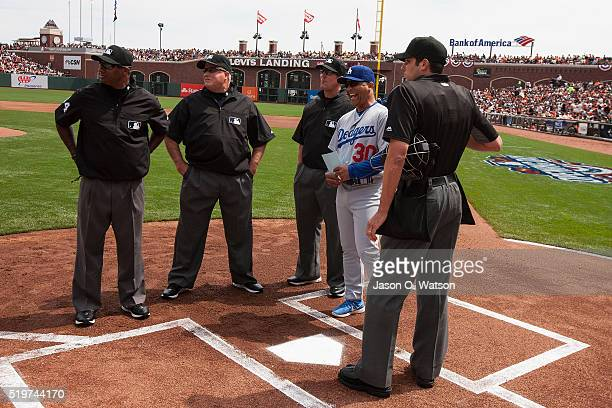 Dave Roberts of the Los Angeles Dodgers stands beside home plate with umpire John Tumpane umpire Jeff Kellogg umpire Brian O'Nora and umpire Alan...