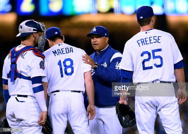 Dave Roberts of the Los Angeles Dodgers takes out Kenta Maeda during the eighth inning at Dodger Stadium on September 19 2018 in Los Angeles...