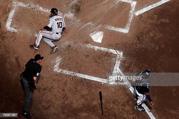 Dave Roberts of the San Francisco Giants slides safely into home plate to score during the game against the Milwaukee Brewers at Miller Park July 22...