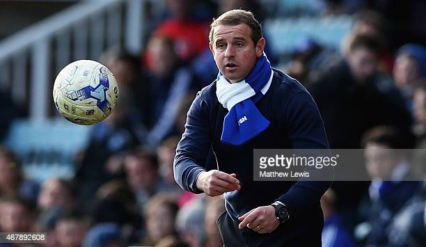 Dave Robertson manager of Peterborough United throws a ball back during the Sky Bet League One match between Peterborough United and Coventry City at...