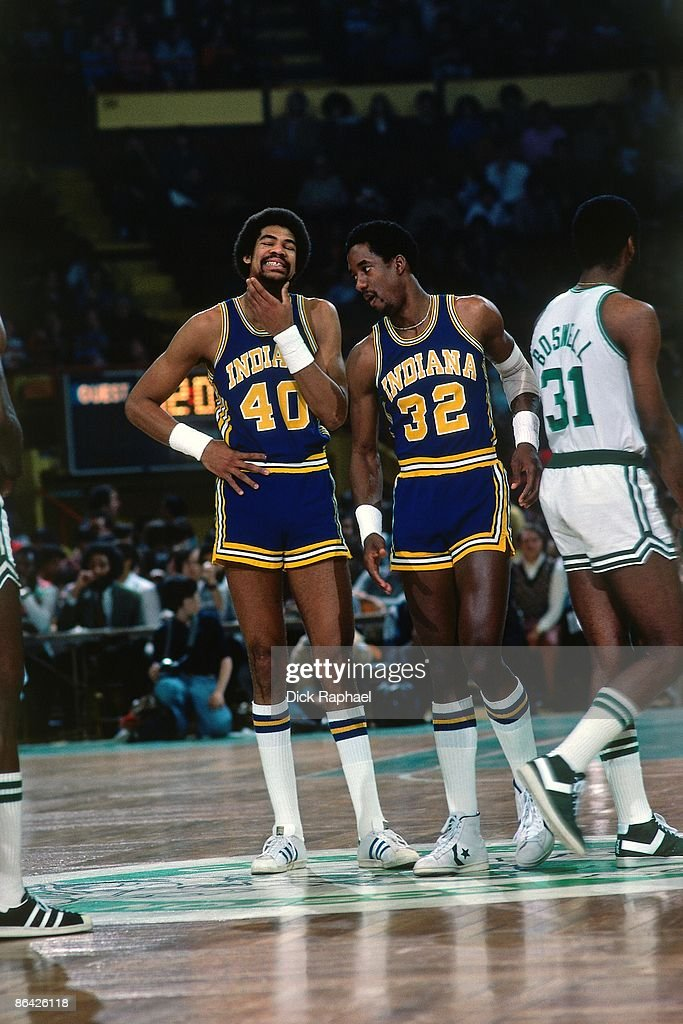 Dave Robisch #40 and Dan Roundfield #32 of the Indiana Pacers talk strategy on the court against Tom Boswell #31 of the Boston Celtics during a game played in 1978 at the Boston Garden in Boston, Massachusetts.