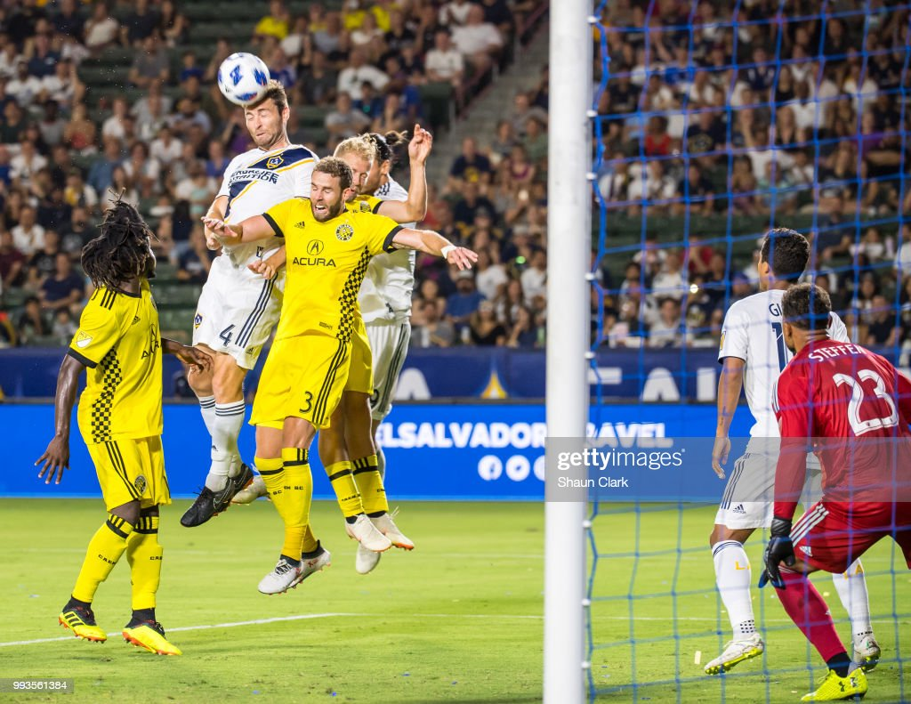Dave Romney #4 of Los Angeles Galaxy gets on the end of a cross during the Los Angeles Galaxy's MLS match against Columbus Crew at the StubHub Center on July 7, 2018 in Carson, California. Los Angeles Galaxy won the match 4-0