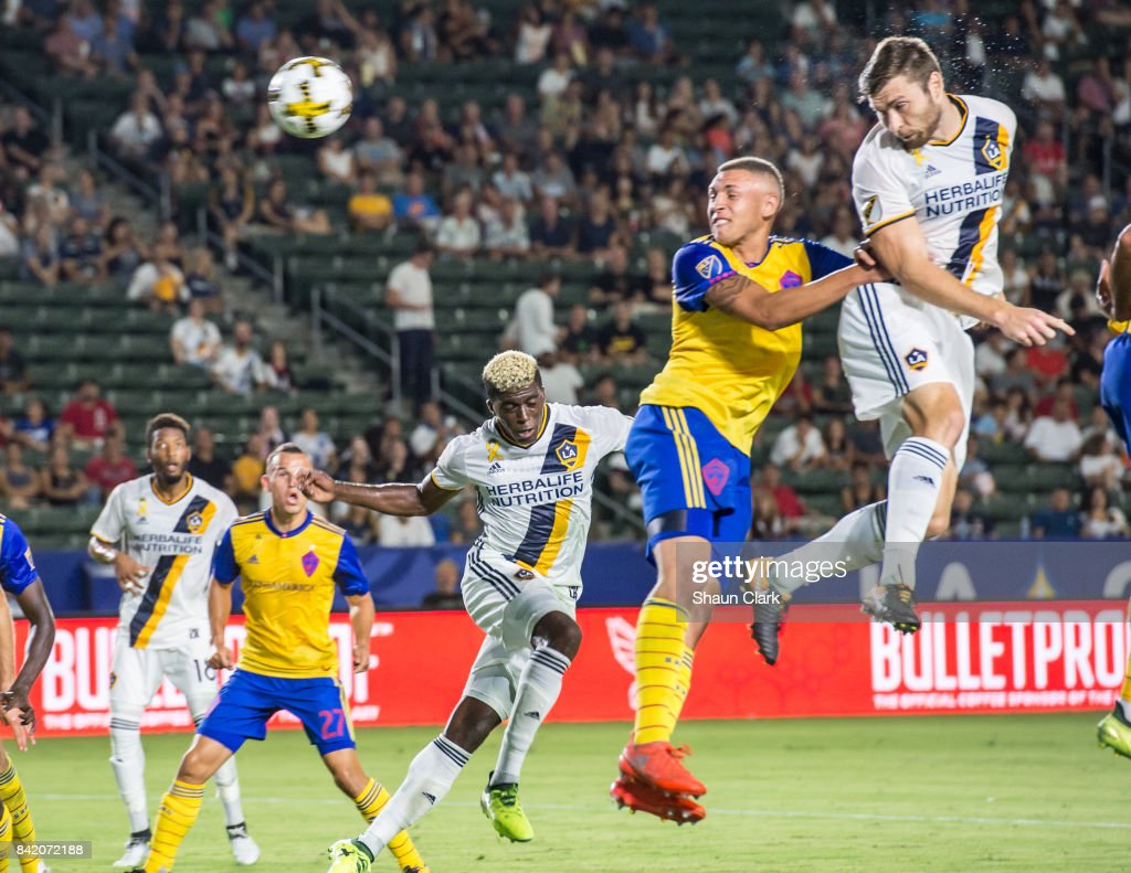 Dave Romney #4 of Los Angeles Galaxy heads the ball towards goal during the Los Angeles Galaxy's MLS match against Colorado Rapids at the StubHub Center on September 2, 2017 in Carson, California. Los Angeles Galaxy won the match