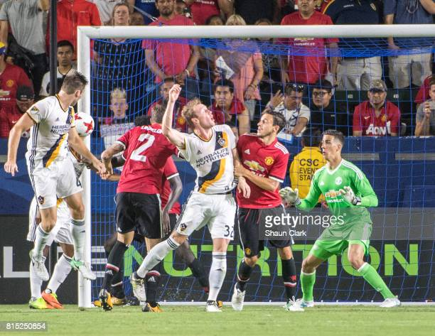 Dave Romney of Los Angeles Galaxy scores a goal during the Los Angeles Galaxy's friendly match against Manchester United at the StubHub Center on...
