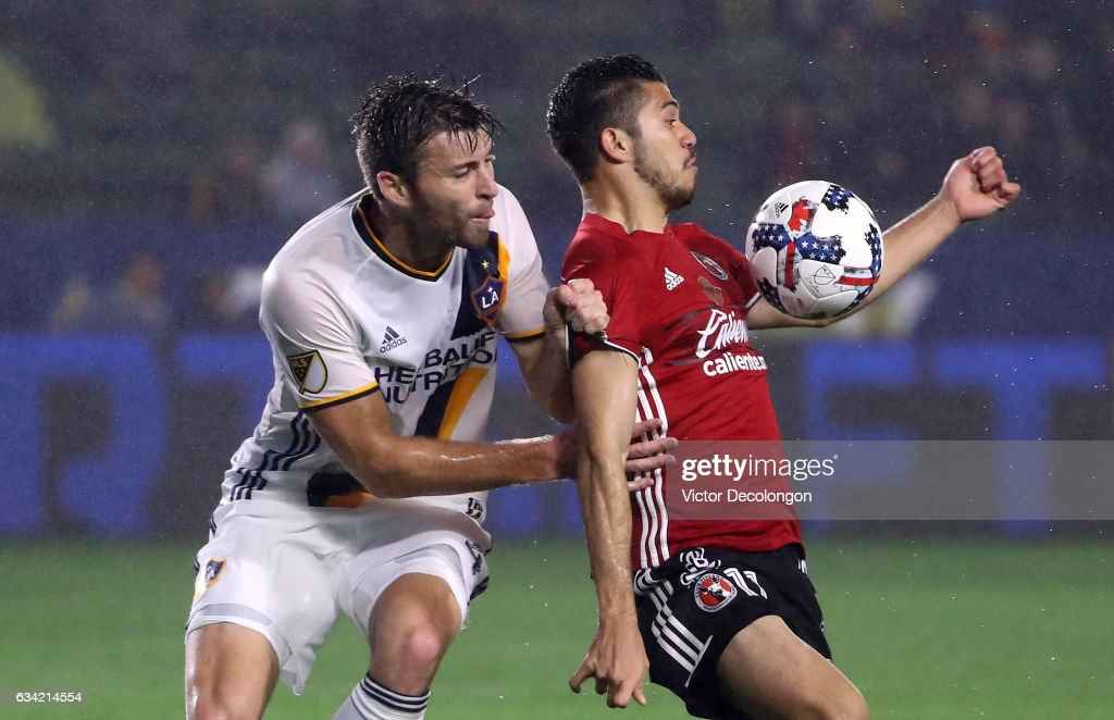 Dave Romney #4 of the Los Angeles Galaxy defends Henry Martin #11 of Club Tijuana in the goal box during their friendly match at StubHub Center on February 7, 2017 in Carson, California.