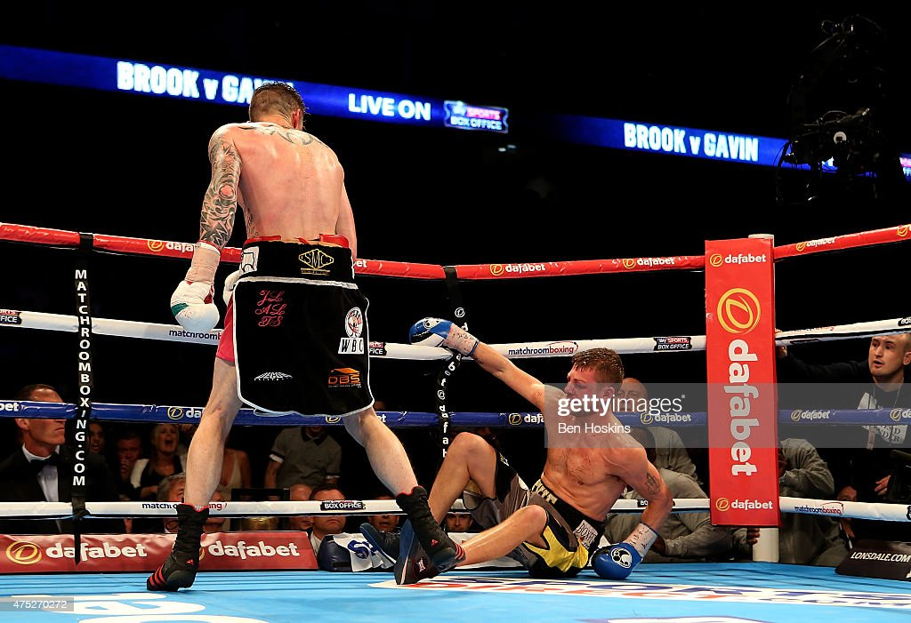 Dave Ryan of England knocks down John Wayne Hibbert of England during their Commenwealth and WBC International Light Welterweight fight at The O2 Arena on May 30, 2015 in London, England.