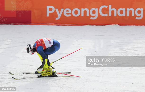 Dave Ryding of Great Britain removes his skiis during the Alpine Team Event Quarterfinals on day 15 of the PyeongChang 2018 Winter Olympic Games at...