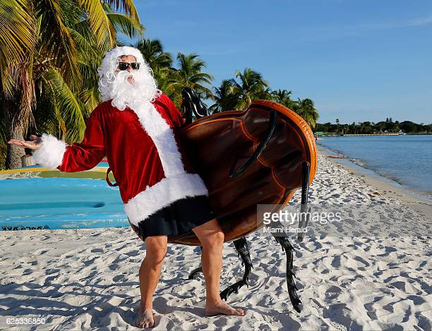 Dave Santa Claus Barry finds the perfect beach spot for his Giant Cockroach Pool Float to chillax prior to the hectic Christmas bad gifts season