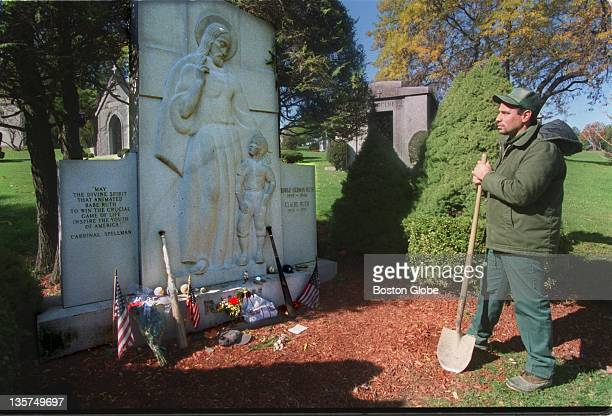Dave Santiago, gravedigger, at Babe Ruth''s grave, at Gate of Heaven cemetery in Hawthorne, New York.