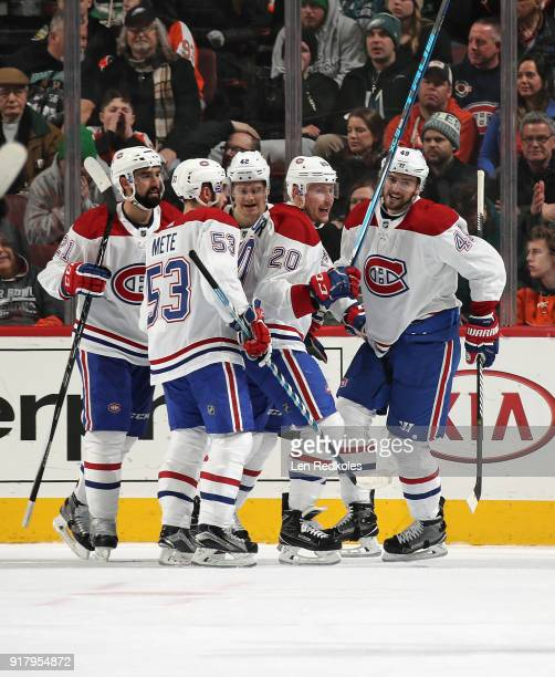 Dave Schlemko Victor Mete Byron Froese Nicolas Deslauriers and Logan Shaw of the Montreal Canadiens celebrate a second period goal against the...