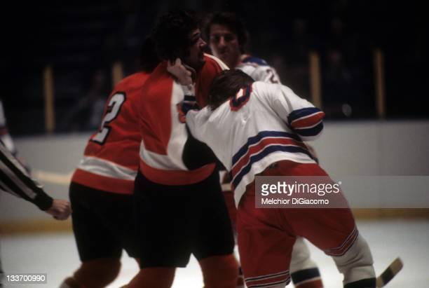 Dave Schultz of the Philadelphia Flyers fights with Glen Sather of the New York Rangers circa 1972 at the Madison Square Garden in New York New York