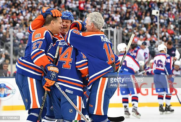 Dave Semenko BJ MacDonald and Craig MacTavish of the Edmonton Oilers alumni celebrate after a goal on Winnipeg Jets alumni during the 2016 Tim...