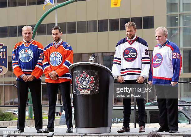 Dave Semenko Cam Talbot of the Edmonton Oilers Blake Wheeler and Thomas Steen of the Winnipeg Jets pose for pictures during the press conference for...