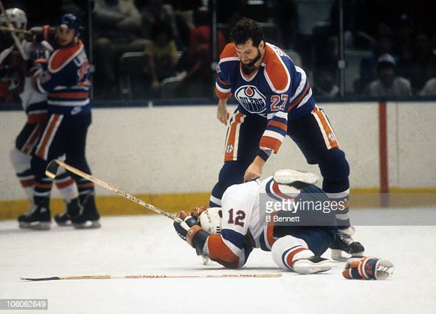 Dave Semenko of the Edmonton Oilers looks to fight Duane Sutter of the New York Islanders during their game circa 1982 at the Nassau Coliseum in...