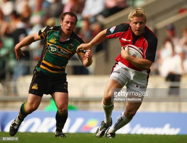 Dave Seymour of Saracens beats the Northampton Saints defence to score a try during the Middlesex Sevens Plate Final match between Northampton Saints...