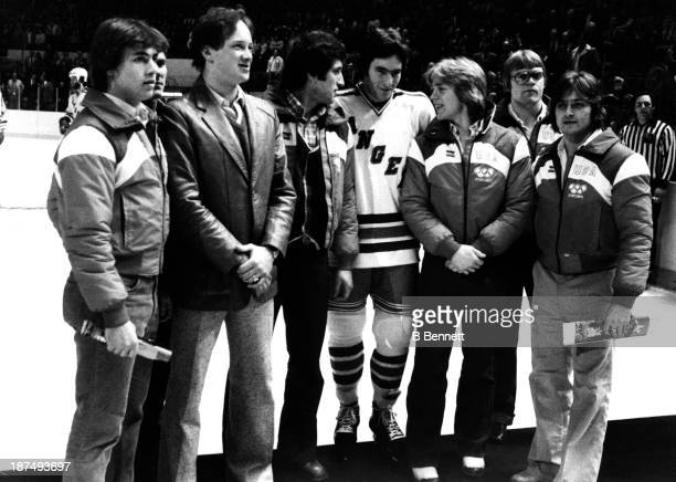 Dave Silk of the New York Rangers stands with his former Olympic teammates before his game against the Buffalo Sabres on March 5 1980 at the Madison...