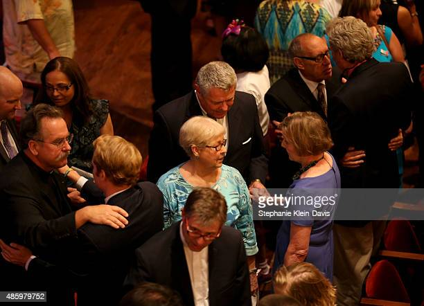 Dave Skole, with Christ Lutheran Church in Roanoke consoles Chris Hurst, boyfriend and colleague of Alison Parker, at the Interfaith Service of...