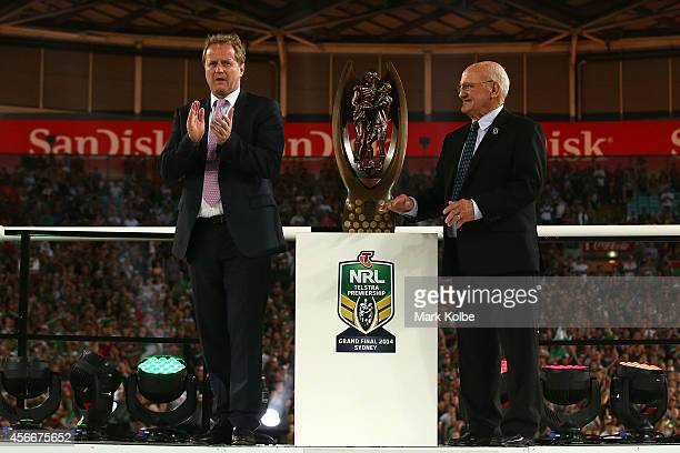 Dave Smith and Arthur Summons stand beside the preimership trophy after the 2014 NRL Grand Final match between the South Sydney Rabbitohs and the...