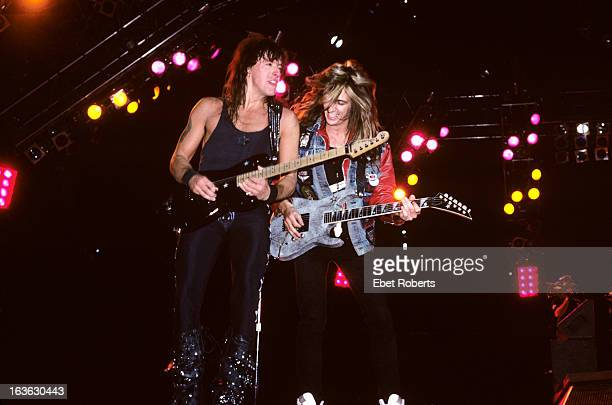 Dave 'Snake' Sabo of Skid Row guests on stage with Richie Sambora during a Bon Jovi concert at Giants Stadium in East Rutherford New Jersey on 11th...