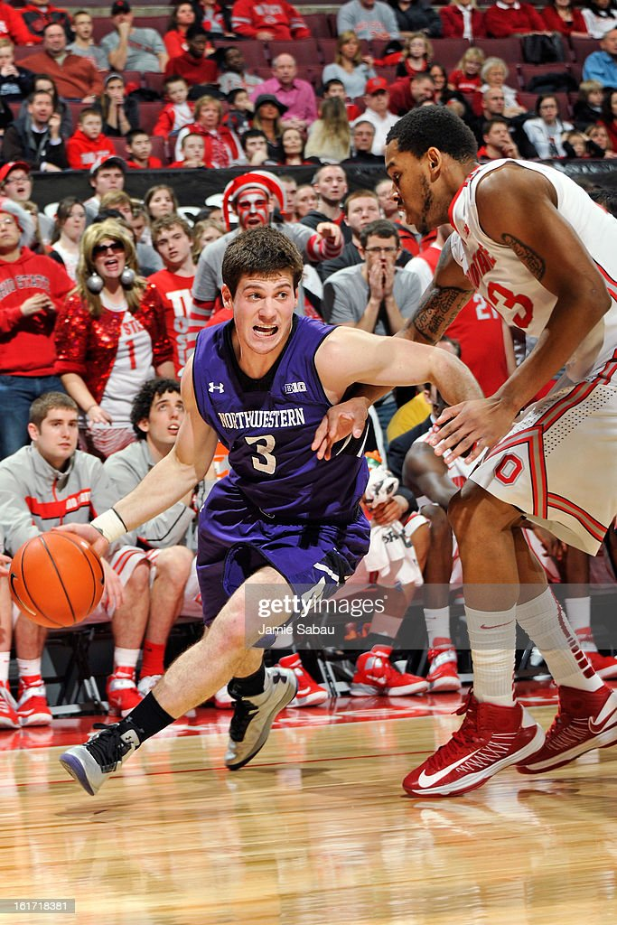 Dave Sobolweski #3 of the Northwestern Wildcats drives baseline around Amir Williams #23 of the Ohio State Buckeyes on February 14, 2013 at Value City Arena in Columbus, Ohio. Ohio State defeated Northwestern 69-59.