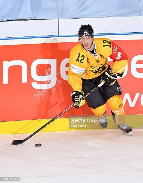 Dave Spina of SaiPa Lappeenranta handles the puck during the Champions Hockey League game between ERC Ingolstadt and SaiPa Lappeenranta on august 23,...
