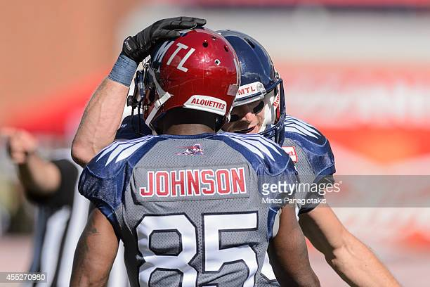 Dave Stala congratulates teammate Chad Johnson of the Montreal Alouettes during the CFL game against the Hamilton TigerCats at Percival Molson...