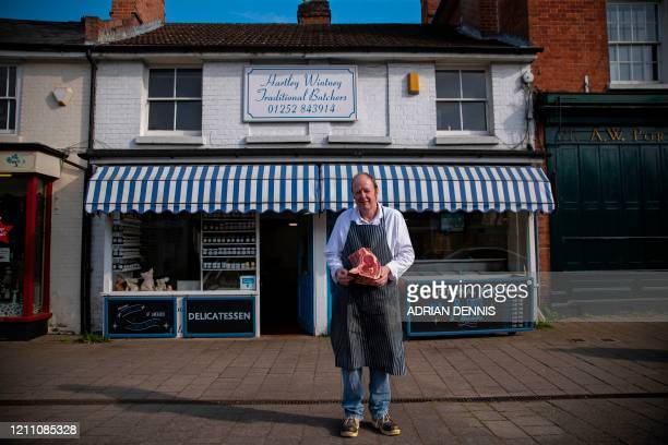 Dave Stanton a butcher poses for a picture outside his shop in Hartley Wintney England on April 25 2020 during the COVID19 coronavirus pandemic Ahead...
